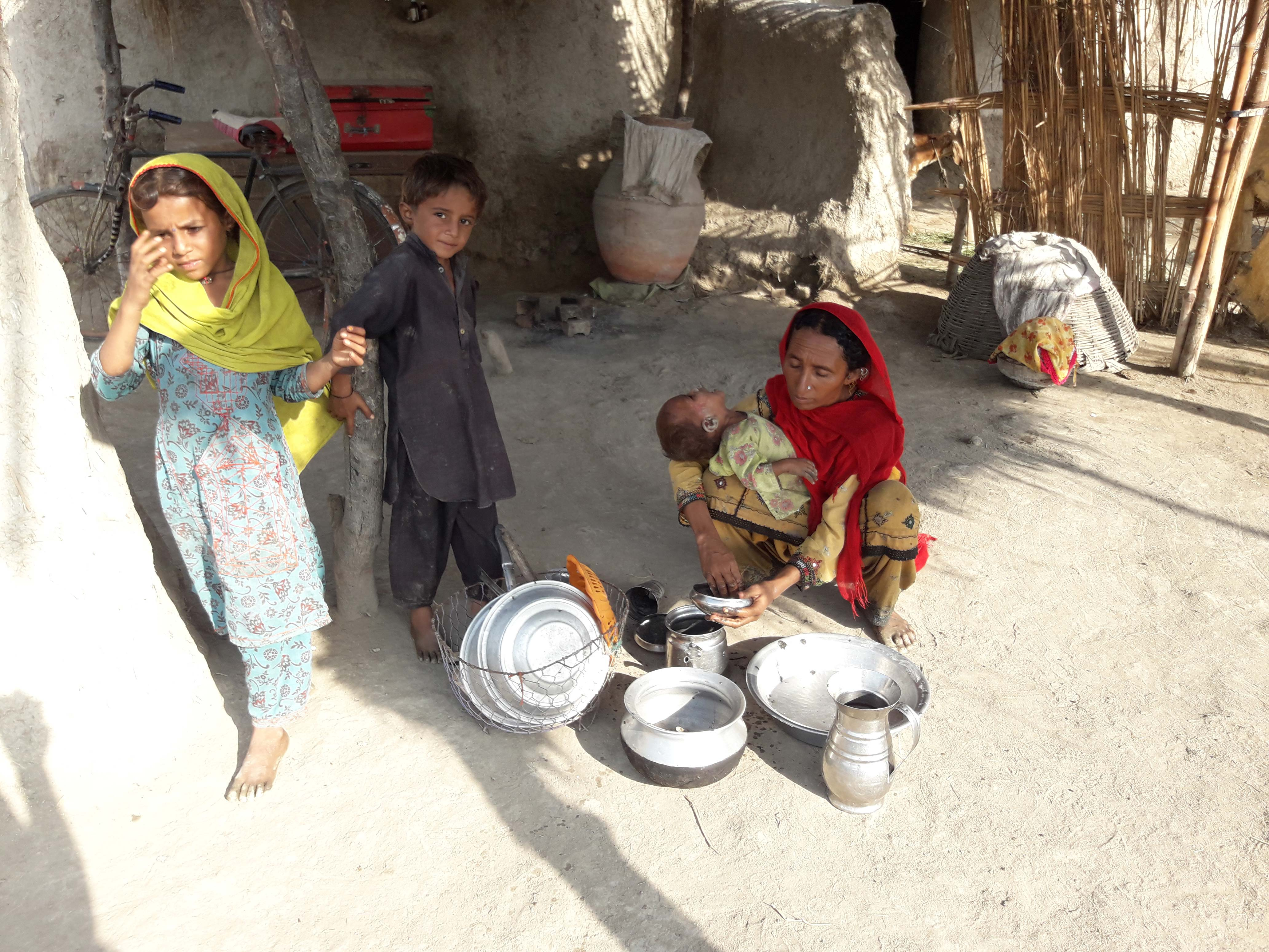 Village women manage children, household chores and farming